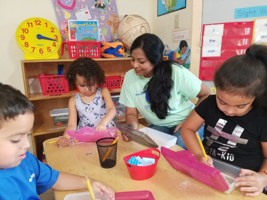 naseema teaching art to children